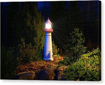 Lit-up Lighthouse Canvas Print by Kathryn Meyer