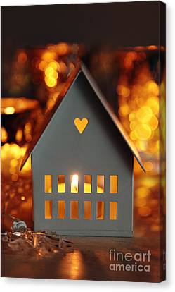 Little Gray House Lit With Candle For The Holidays Canvas Print by Sandra Cunningham