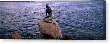 Little Mermaid Statue On Waterfront Canvas Print by Panoramic Images