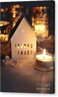Little White House Lit With Candle For The Holidays Canvas Print by Sandra Cunningham
