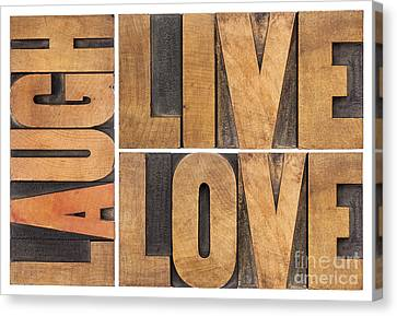 Canvas Print featuring the photograph Live Love And Laugh In Wood Type by Marek Uliasz