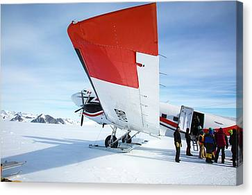 Loading An Aircraft In Antarctica Canvas Print by Peter J. Raymond