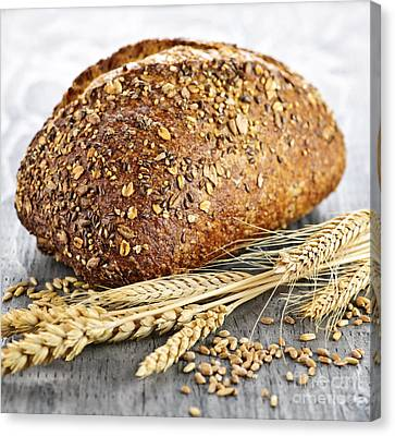 Loaf Of Multigrain Bread Canvas Print by Elena Elisseeva