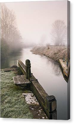 Canvas Print featuring the photograph Lock Gates On A Still Misty Morning. by Trevor Chriss