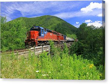 Locomotive And River Valley Canvas Print by John Burk