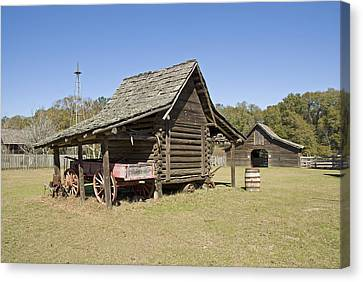 Canvas Print featuring the photograph Log Cabin And Barn by Charles Beeler