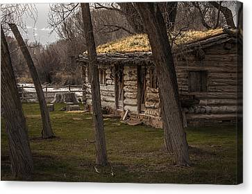 Log Cabin By The River Canvas Print by David Kehrli