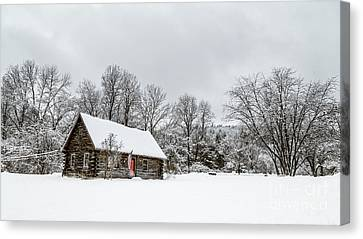 Log Cabin In The Snow Canvas Print by Edward Fielding