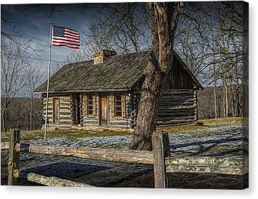 Log Cabin Outpost In Missouri With American Flag Canvas Print by Randall Nyhof