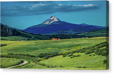 Log Cabin With Mountains And Green Canvas Print