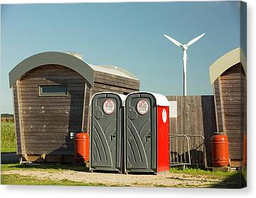 Log Cabins And A Wind Turbine Canvas Print by Ashley Cooper