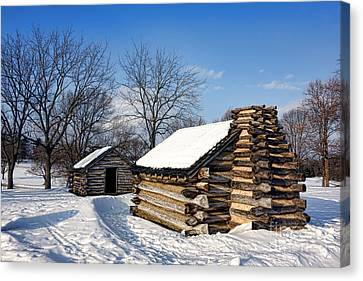 Log Cabins In Snow Canvas Print