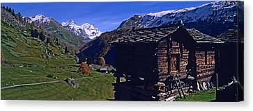 Log Cabins On A Landscape, Matterhorn Canvas Print by Panoramic Images