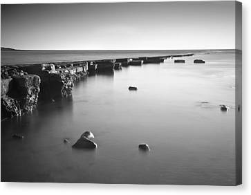 Long Exposure Image Of Tide Going Out Over Rock Ledge During Sun Canvas Print by Matthew Gibson