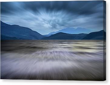 Long Exposure Landscape Of Stormy Sky And Mountains  Over Lake Canvas Print by Matthew Gibson
