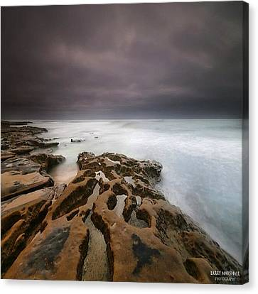 Long Exposure Sunset On A Dark Stormy Canvas Print by Larry Marshall