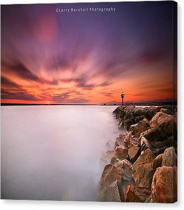 Long Exposure Sunset Shot At A Rock Canvas Print by Larry Marshall