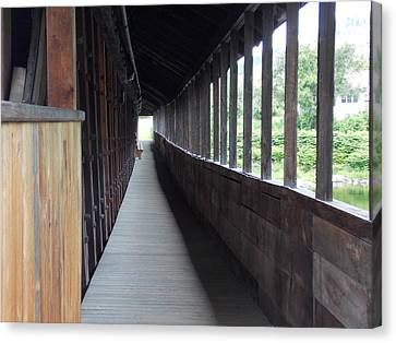 Long Walkway In Covered Bridge Canvas Print by Catherine Gagne