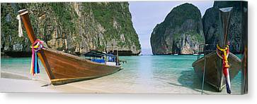 Longtail Boats Moored On The Beach Canvas Print by Panoramic Images