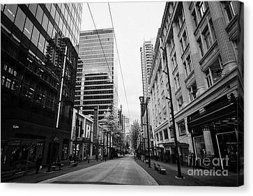 Long Street Canvas Print - looking down granville street shopping area between the bay and pacific centre Vancouver BC Canada by Joe Fox