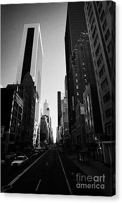 looking down West 57th Street midtown new york city Canvas Print by Joe Fox