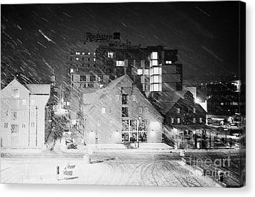 Snowy Night Night Canvas Print - looking out atTromso bryggen quay harbour on a cold snowy winter night troms Norway europe by Joe Fox