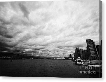 looking out from coal harbour into Vancouver Harbour on an overcast cloudy day BC Canada Canvas Print by Joe Fox