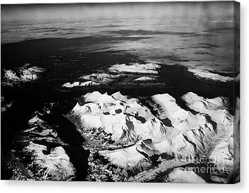 Looking Out Of Aircraft Window Over Snow Covered Fjords And Coastline Of Norway Northern Europe Canvas Print by Joe Fox