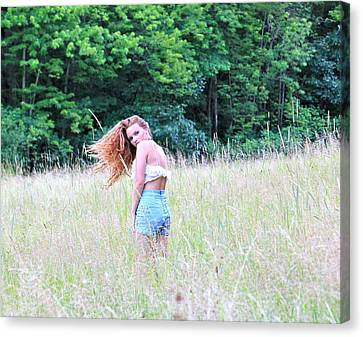 Lost In A Feild Canvas Print by Amanda Just