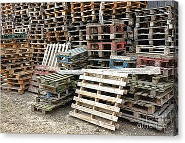 Pallet Canvas Print - Lots Of Pallets by Olivier Le Queinec