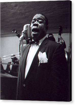 Louis Armstrong Sings Into The Mic. Canvas Print by Retro Images Archive