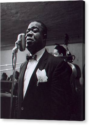 Louis Armstrong Stands In Front Of The Microphone Canvas Print by Retro Images Archive