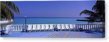 Empty Chairs Canvas Print - Lounge Chairs, Giraavaru, Maldives by Panoramic Images