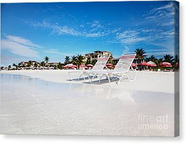 Lounge Chairs On Grace Bay Beach Canvas Print by Jo Ann Snover