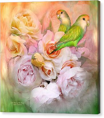 Canvas Print featuring the mixed media Love Among The Roses by Carol Cavalaris