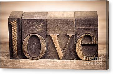 Love In Printing Blocks Canvas Print by Jane Rix