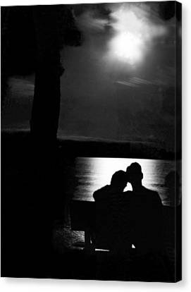 Lovers Sitting Moonlight Canvas Print by Underwood Archives