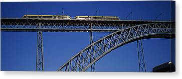 Low Angle View Of A Bridge, Dom Luis I Canvas Print by Panoramic Images
