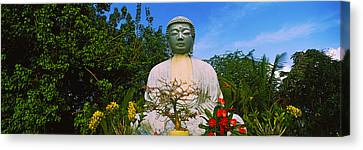 Low Angle View Of A Buddha Statue Canvas Print