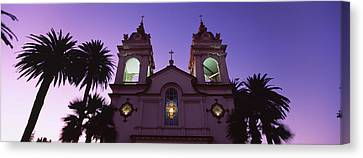 Low Angle View Of A Cathedral Lit Canvas Print by Panoramic Images