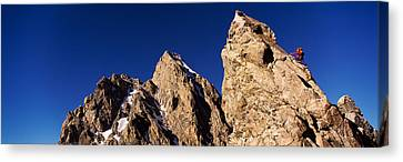 Low Angle View Of A Man Climbing Canvas Print by Panoramic Images