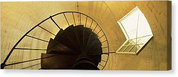 Low Angle View Of A Spiral Staircase Canvas Print by Panoramic Images