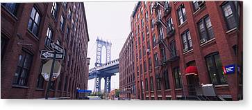 Fire Escape Canvas Print - Low Angle View Of A Suspension Bridge by Panoramic Images