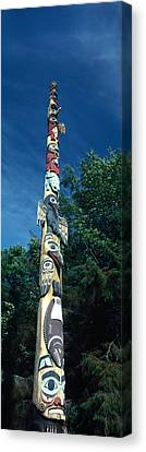 Low Angle View Of A Totem Pole, Totem Canvas Print by Panoramic Images