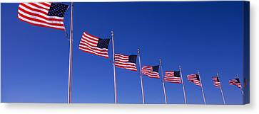Low Angle View Of American Flags Canvas Print