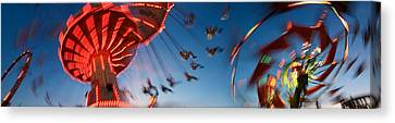 Low Angle View Of Amusement Park Rides Canvas Print by Panoramic Images