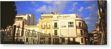 Low Angle View Of Buildings, Sitges Canvas Print by Panoramic Images