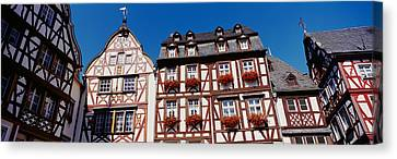 Low Angle View Of Decorated Buildings Canvas Print by Panoramic Images