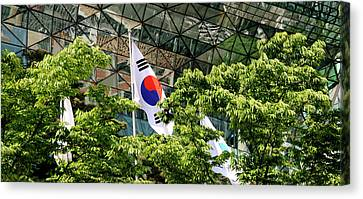 Low Angle View Of Flags And Trees Canvas Print