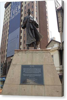 Low Angle View Of Mahatma Gandhi Statue Canvas Print by Panoramic Images